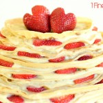 Crepe Cake with Sliced Strawberries by 1 Fine Cookie, crepes, crepe, cake, recipe, tiered, three, three-tiered, strawberry hearts, strawberries, sliced, wedding, red, white, french, pastry, creme, cream, whipped, vanilla, how to, diy, alternative, tutorial, video, kitchenaid, strawberry heart, heart, cut a strawberry, instructions, thin, filling, what pan to use, skillet, to use, batter, cook, non-cake, cake alternatives,