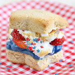 4th of July American Strawberry Shortcake S'more by 1 Fine Cookie, strawberry, shortcake, s'mores, red, white, blue, america, american, flag, summer, dessert, recipe, 4th, july, independence, day, white, chocolate, ganache, marshmallow, cream, fluff, strawberries, stars, sprinkles, biscuits, flag, cookout, candy, party, outdoor, picnic, food,