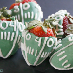 Football Strawberries by 1 Fine Cookie, Snickers, super bowl , dessert, filled, stuffed, candy, strawberries, football, field, giveaway, contest, sweepstakes, strawberry, chocolate, dipped, valentine's, day, gift, diy, how to, candy, melts, decorating, white, green, piping, recipe, fruit, caramel, peanuts, nfl, patriots, seahawks, tailgate, tailgating, cute, party, food, free, superbowl, nougat, ideas, leftover,