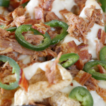 Three Little Pigs Pulled Pork Nachos with homemade cheese sauce by 1 Fine Cookie, pulled pork, pork rinds, bacon, white, queso, cheddar, sauce, green, hatch, chiles, sports, football, tailgate, shredded, cheese, appetizer, super, bowl, superbowl, recipes, ideas, parties, easy, food porn, deflategate, patriots, seahawks, ridiculous, jalapeno, bake, how to, make, baseball, stadium, recipe, hack, bowl, helmet, diy,